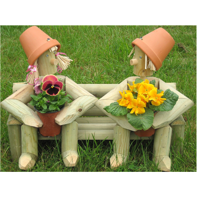 Wooden garden flowerpot men two on a bench with fresh plants for Gardening gifts for men
